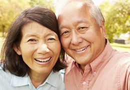 Happy mature couple in park