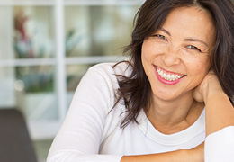 Happy woman smiling wearing a white shirt